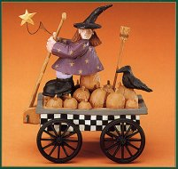 WW6028 Witch and a crow on a wagon full of pumpkins